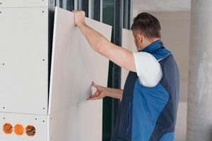 Gyprocker Mounting a Plasterboard on the wall