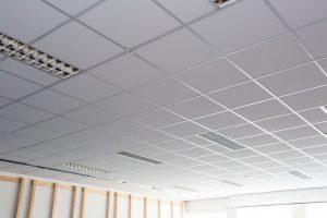 Office ceiling tiles. Metal frame work for suspended ceiling